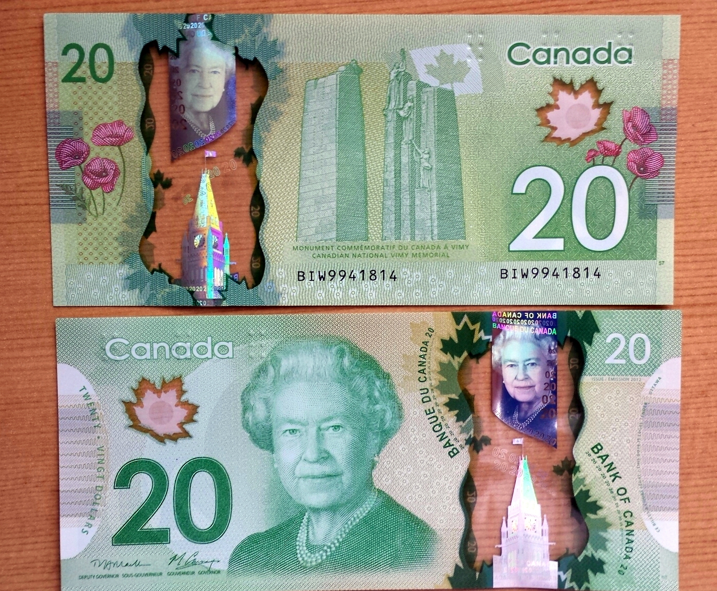 Canadian money $20 bill with protections against counterfeiting
