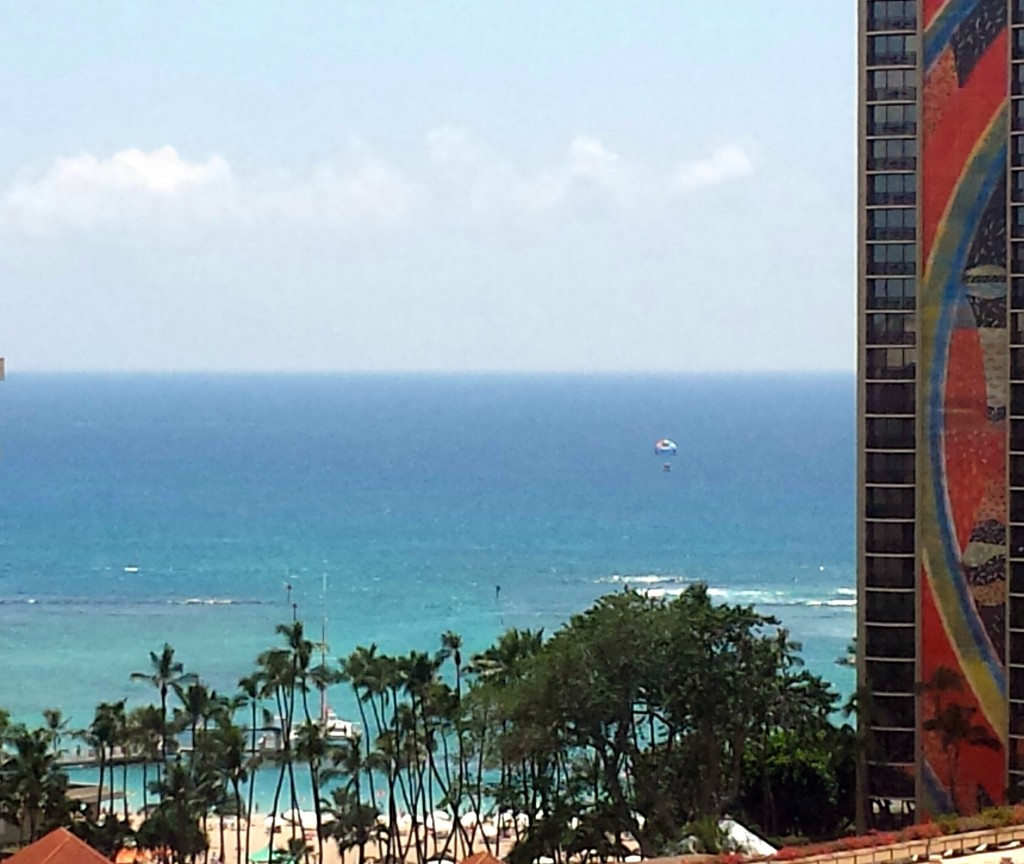 Waikiki Beach from our Lanai with the Hawaiian Hilton Village's Rainbow Tower.