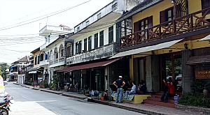 Luang Prabang street scene with French colonial buildings.