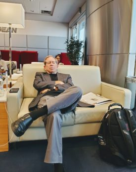 sleeping passenger in an airport lounge